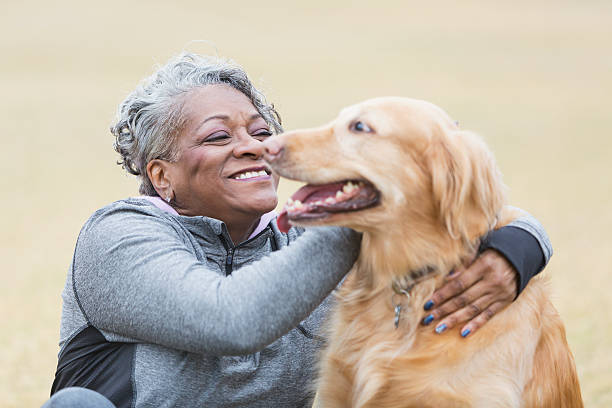 African american woman with pet dog picture id514880599?b=1&k=6&m=514880599&s=612x612&w=0&h=oq0cfps kcuo6gyiwxyx6aod1 5u1kzio75ewm7l3v4=
