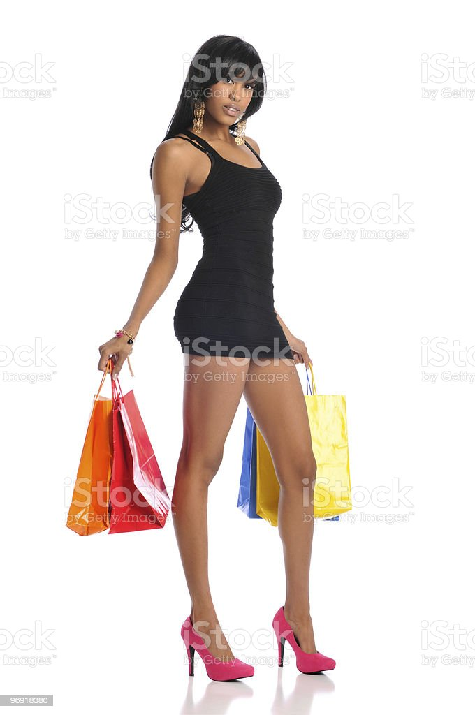 African American woman with shopping bags royalty-free stock photo