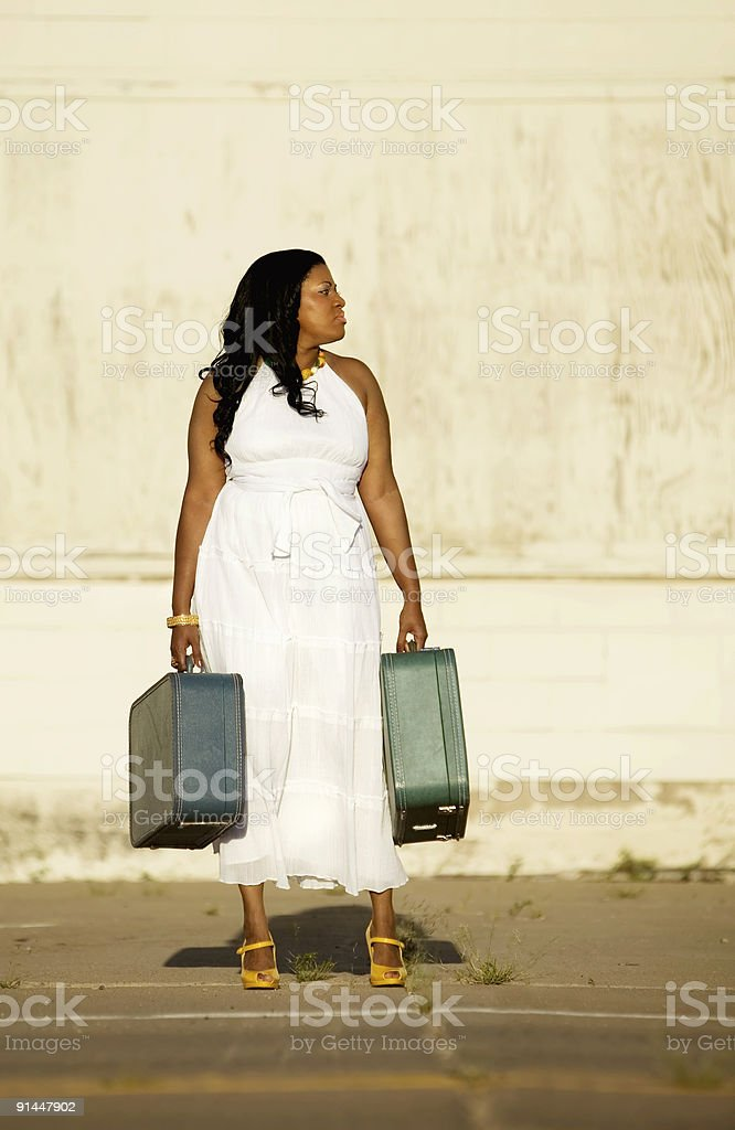 African American woman with suitcases. royalty-free stock photo