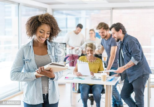 istock African American woman working at a creative office 518869200