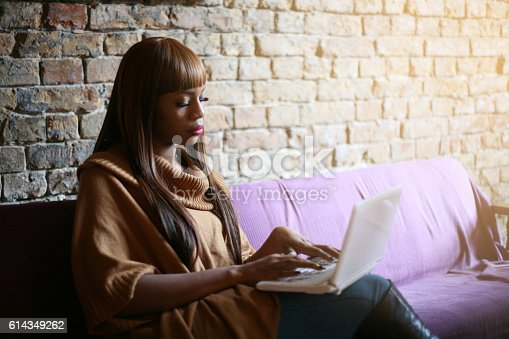 istock African American woman working on laptop. 614349262