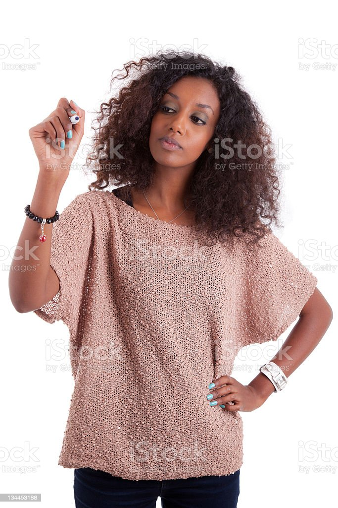 African american woman  writing something on glass board with ma royalty-free stock photo