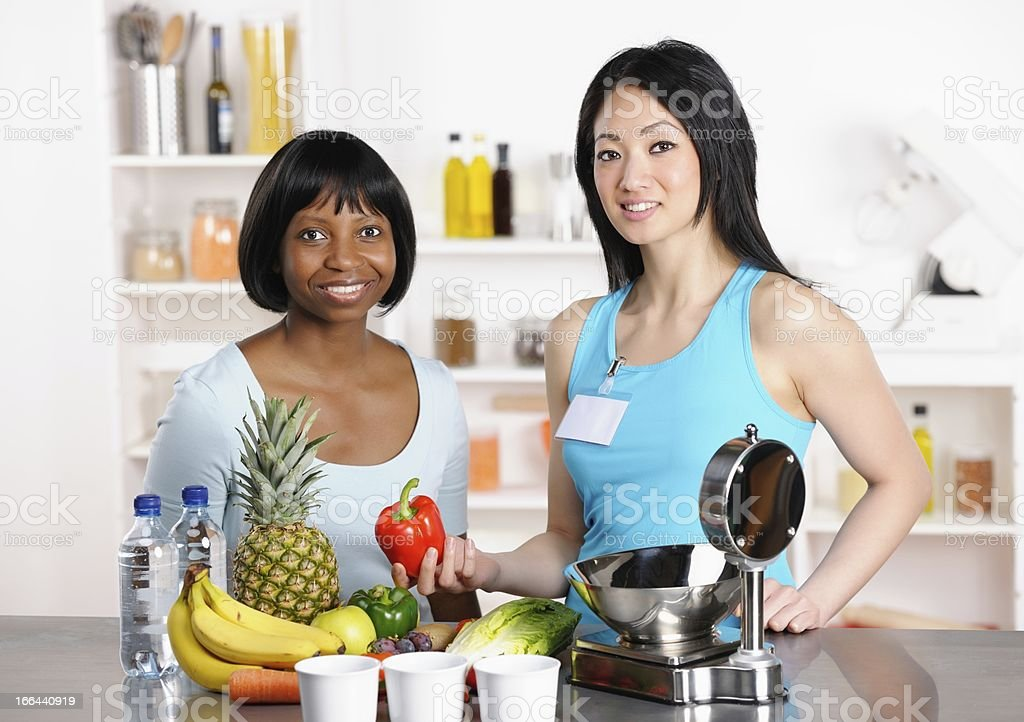 African American Women Discussing Healthy Eating Options With Healthcare Professional stock photo