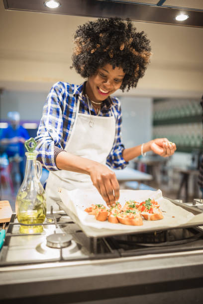 African American women on cooking class stock photo