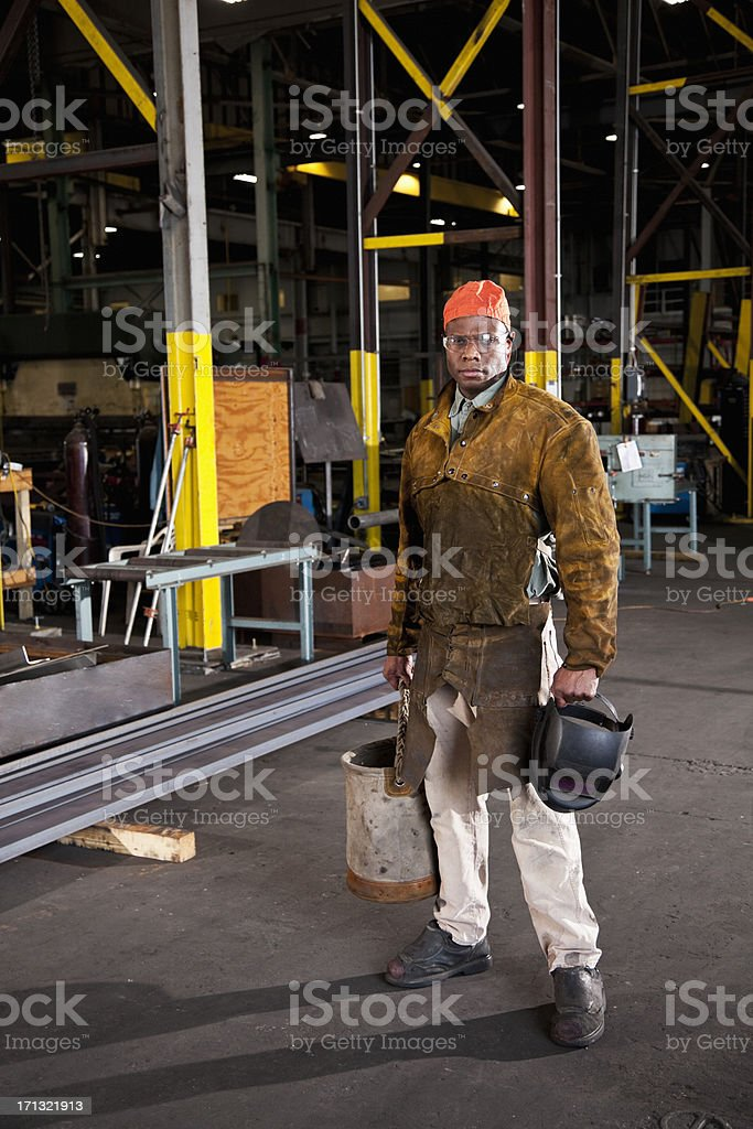 African American worker in fabrication shop stock photo