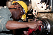 istock African American worker using drill press 175420786