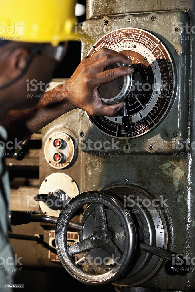 African American worker using drill press stock photo