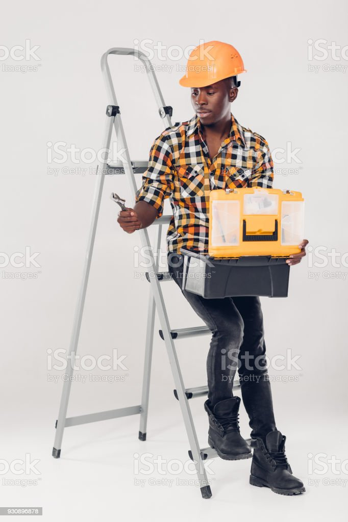African American worker with tool box stock photo