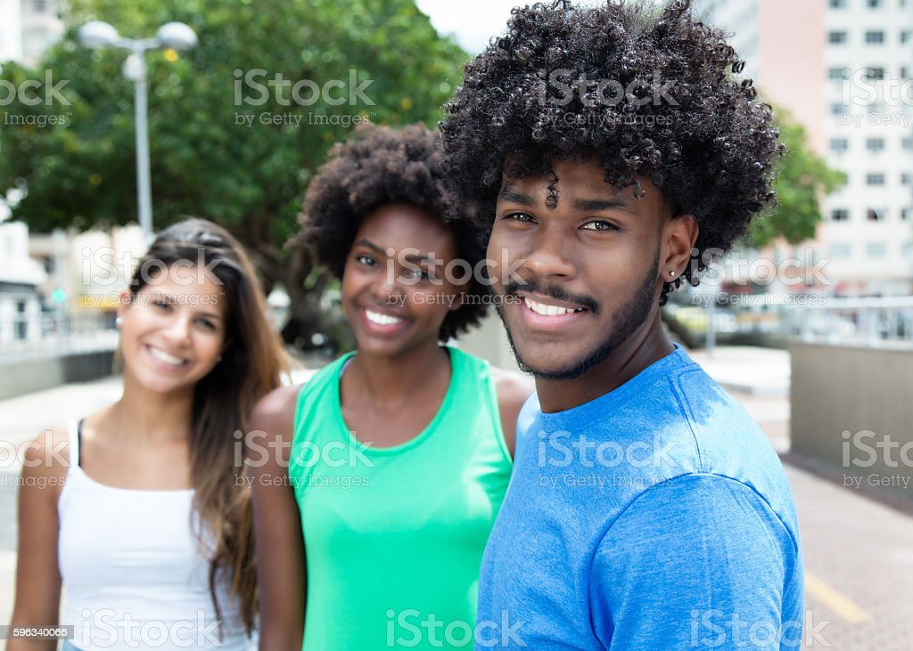 African american young adult with two girls in city royalty-free stock photo