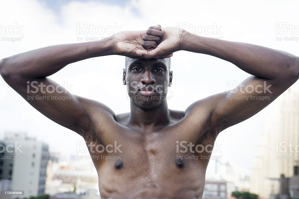 African American Young Man Portrait, Shirtless on City Rooftop royalty-free stock photo