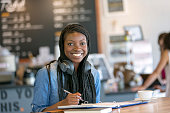 African american young woman drinking coffee and studying