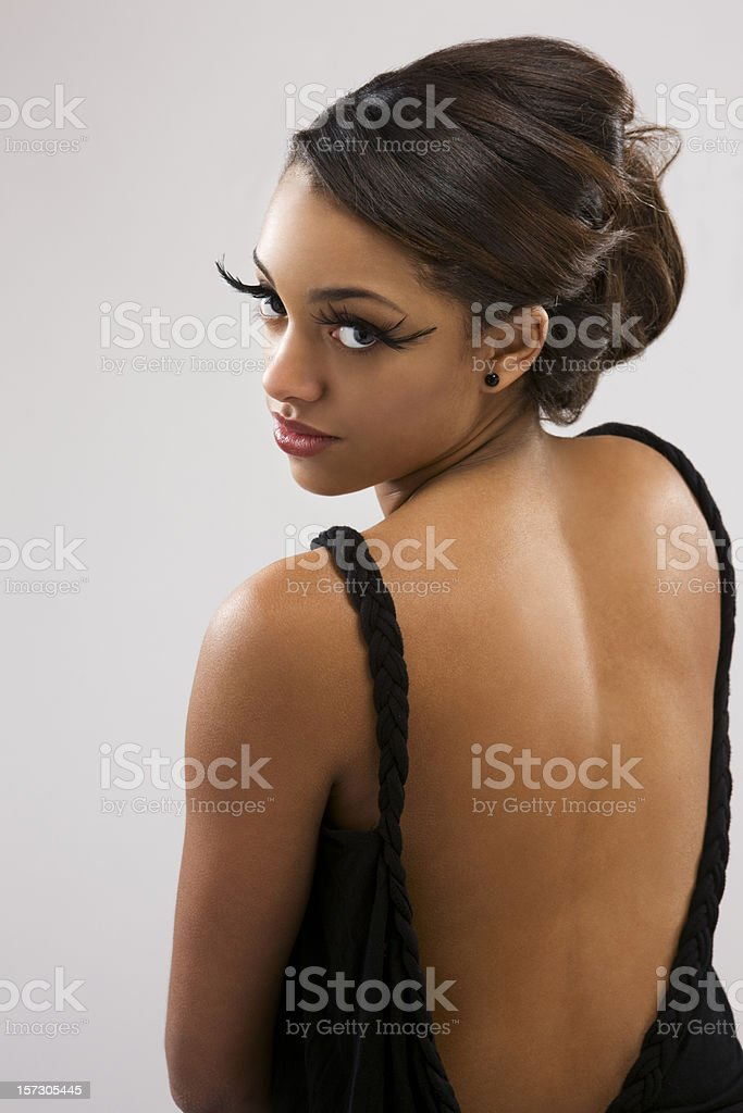 African American Young Woman in Sexy Backless Gown and Makeup stock photo