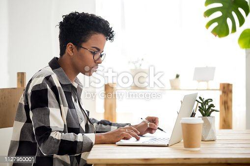 istock African american young woman using laptop working or studying online 1127950001