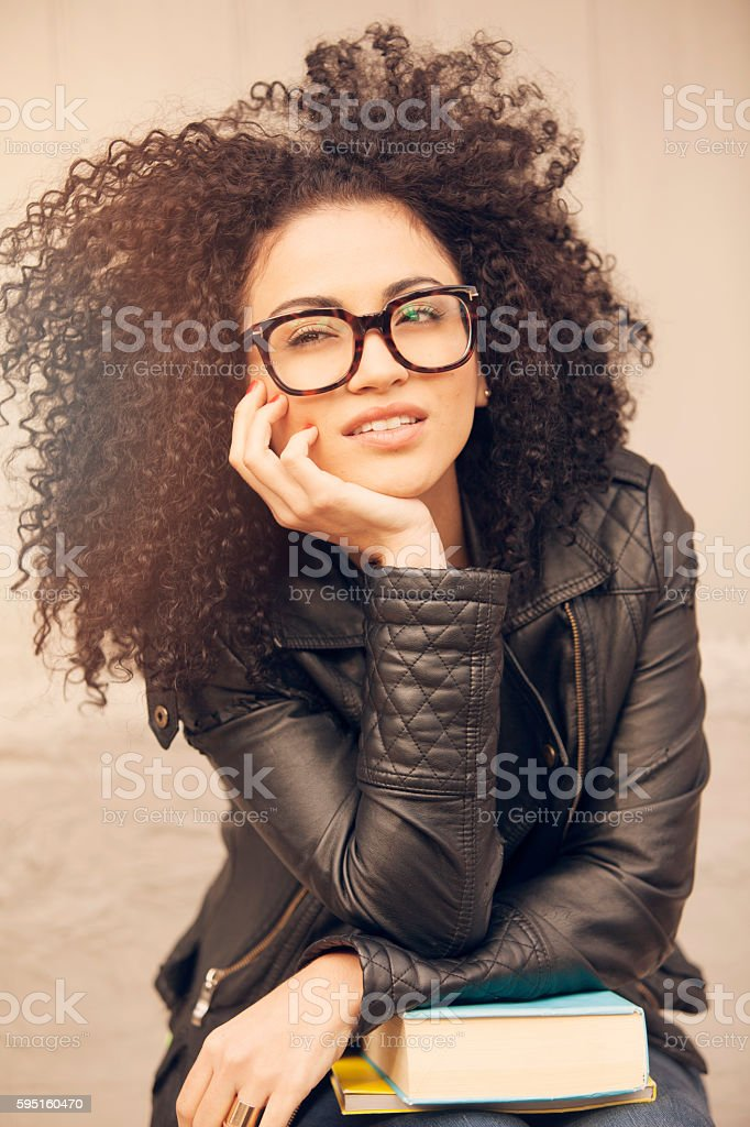 African american young woman with books stock photo