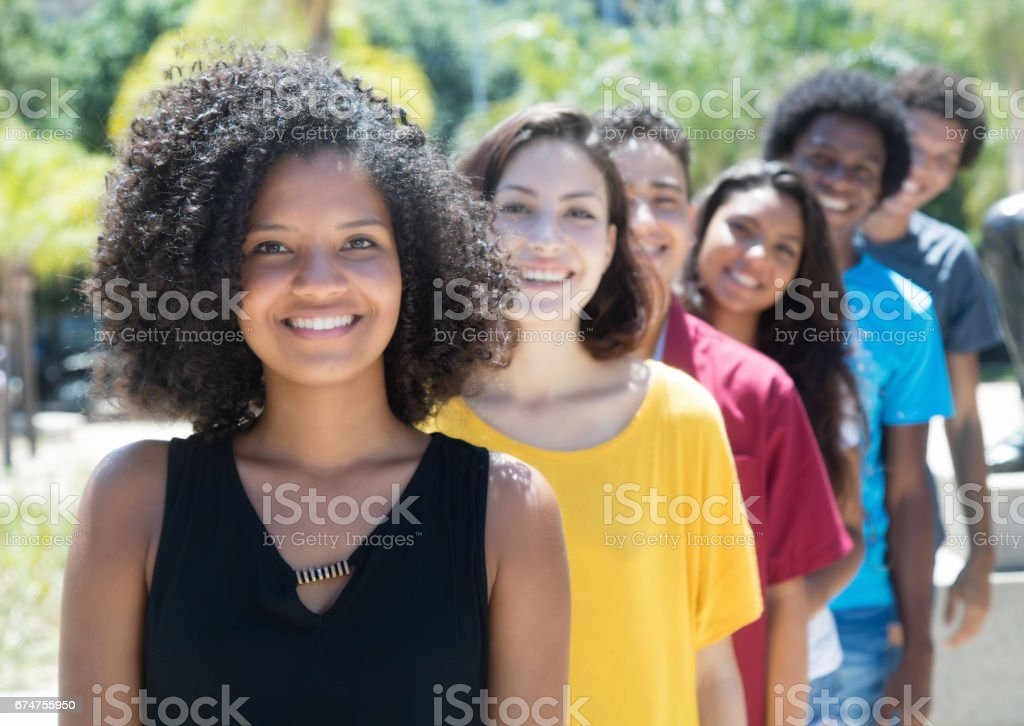 African and american and caucasian and hispanic young adults in a row stock photo