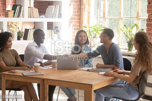 istock African and caucasian businessmen shaking hands at group meeting 1139791114