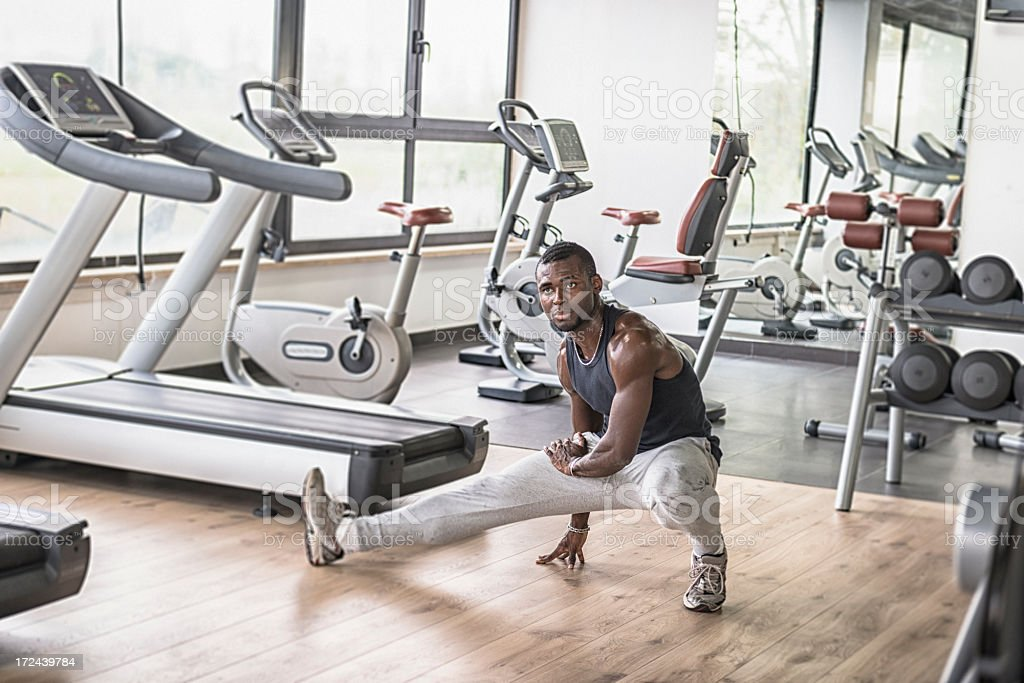 African athlete doing stretching on the gym royalty-free stock photo