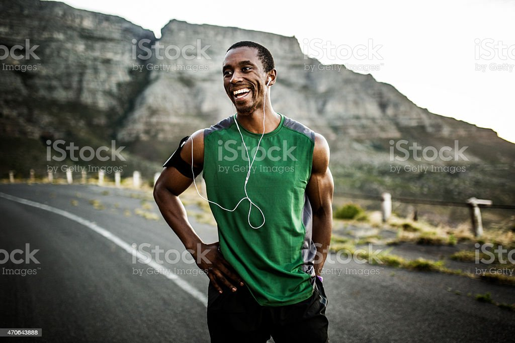 African athlete smiling positively after a good training session royalty-free stock photo