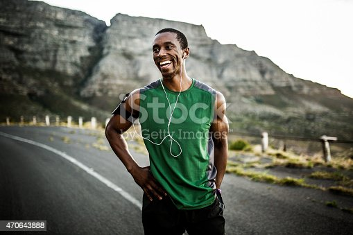 istock African athlete smiling positively after a good training session 470643888