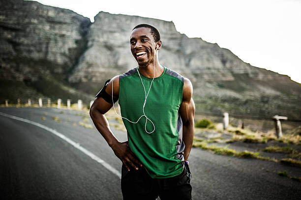 African athlete smiling positively after a good training session stock photo