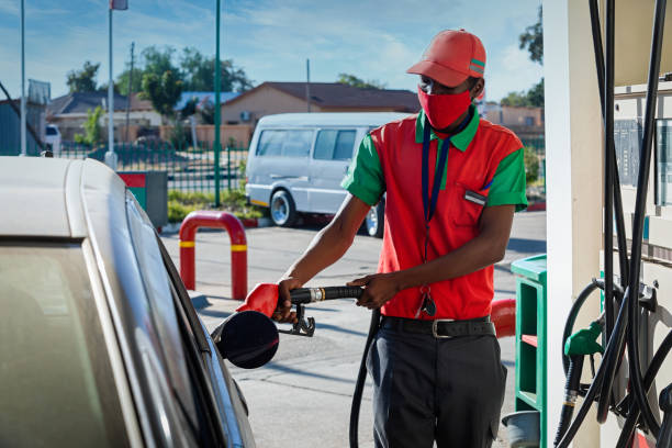 African attendant at a gas station