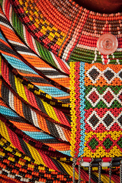 african beaded necklace. - african culture stock photos and pictures