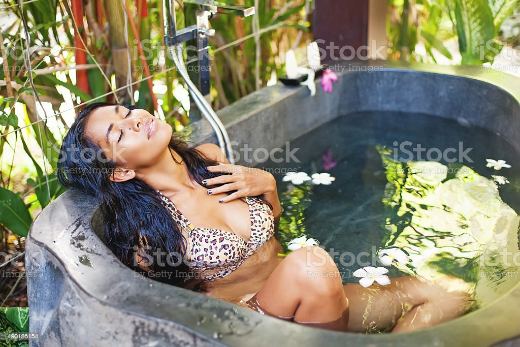 African beautiful girl in bikini relaxing in street bathroon stock photo