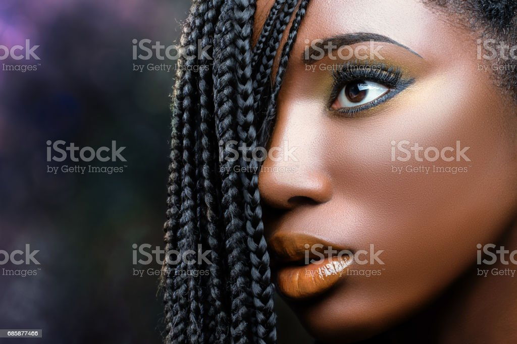 African beauty female face with braids . stock photo