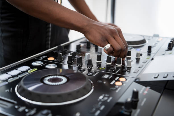 African black girl dj-ing at a fashion party African black girl dj-ing at a fashion party dj stock pictures, royalty-free photos & images