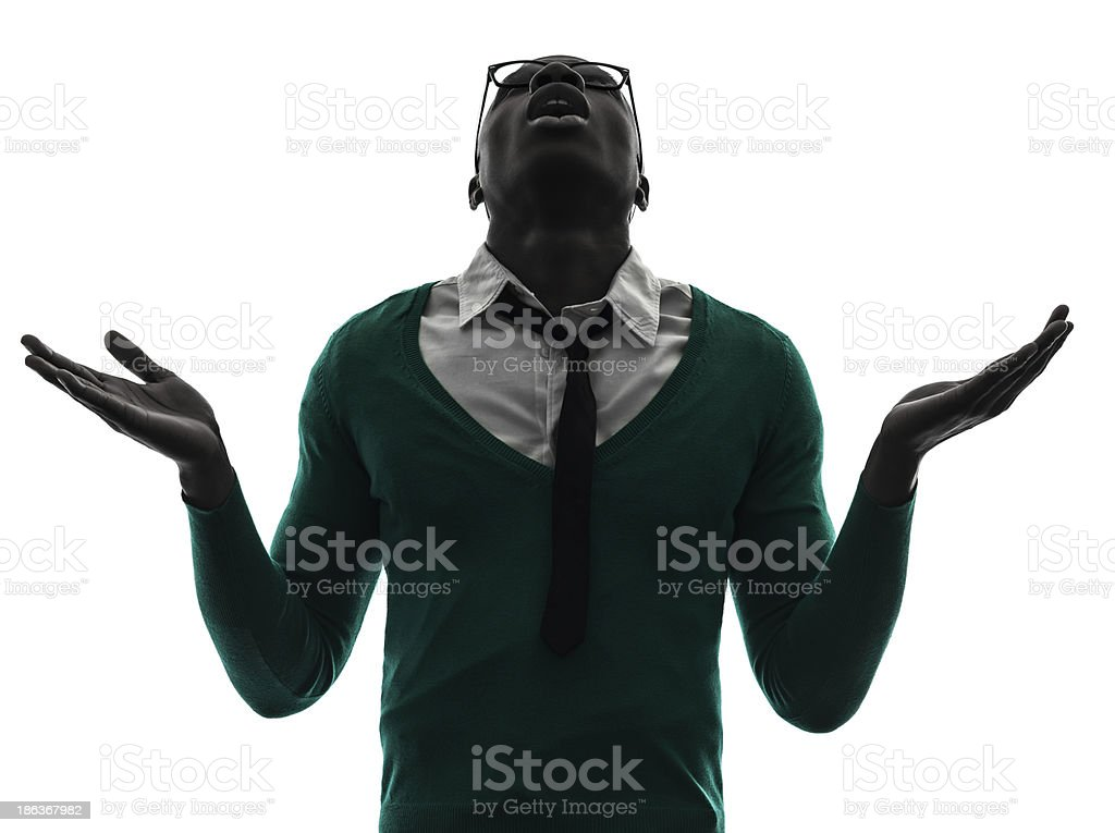 african black man looking up complaigning silhouette stock photo