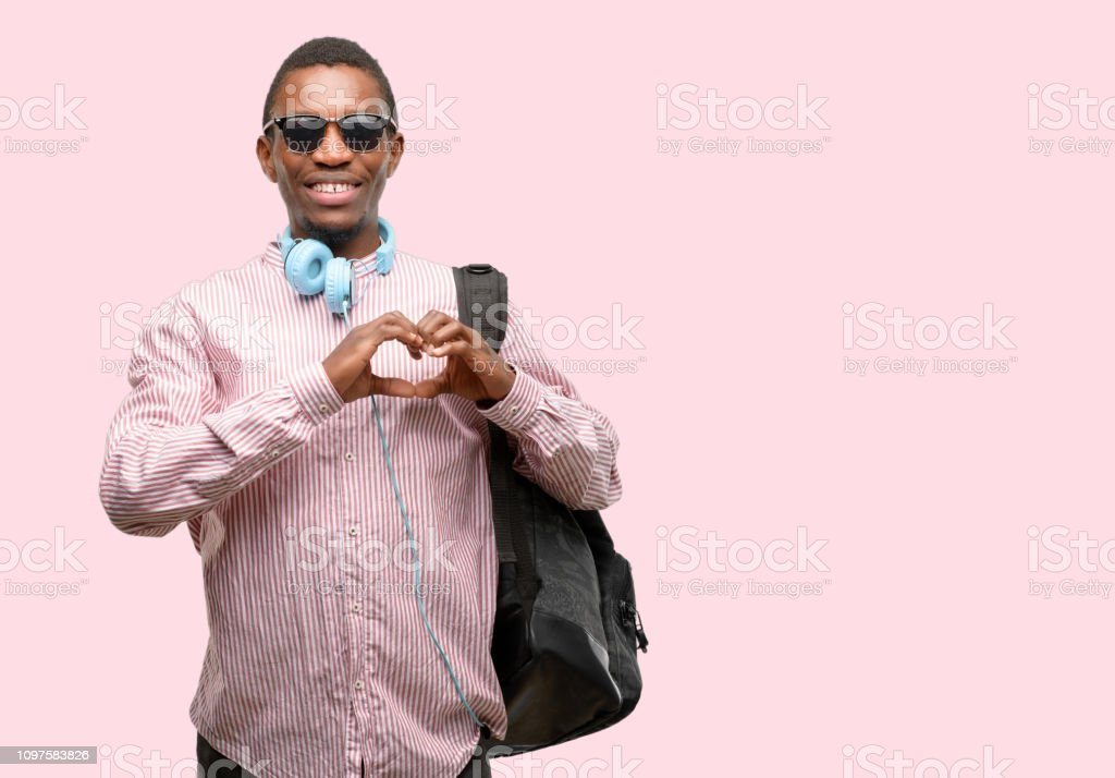 African black man student happy showing love with hands in heart shape expressing healthy and marriage symbol stock photo