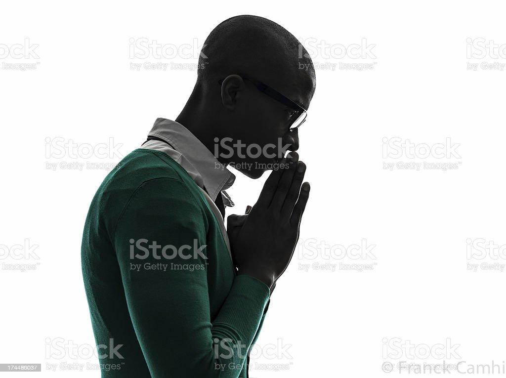 african black man thinking pensive praying silhouette stock photo