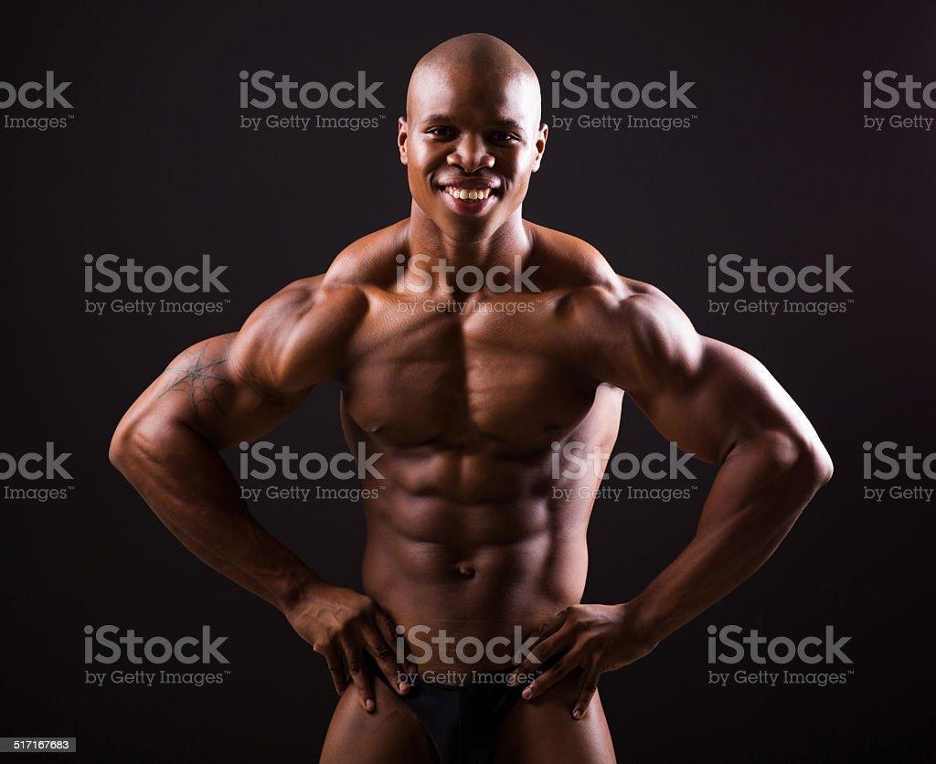 african bodybuilder on black background stock photo