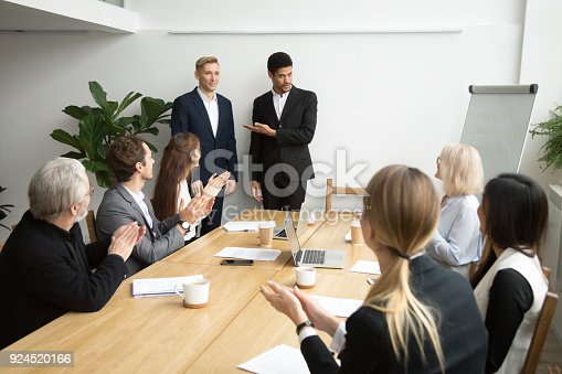 924520144 istock photo African boss introducing new hire employee to corporate team applauding 924520166