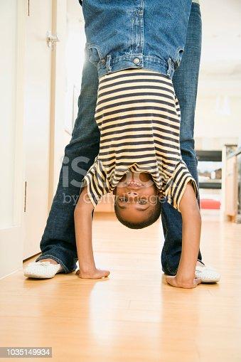 African boy doing handstand