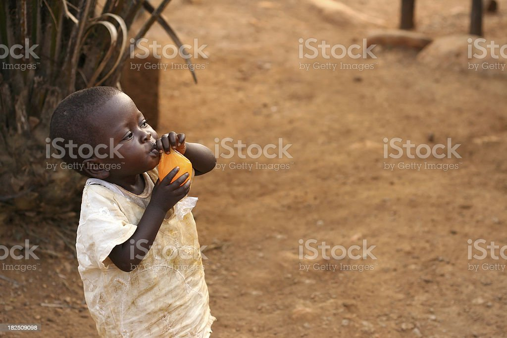 African Boy Drinking Juice royalty-free stock photo