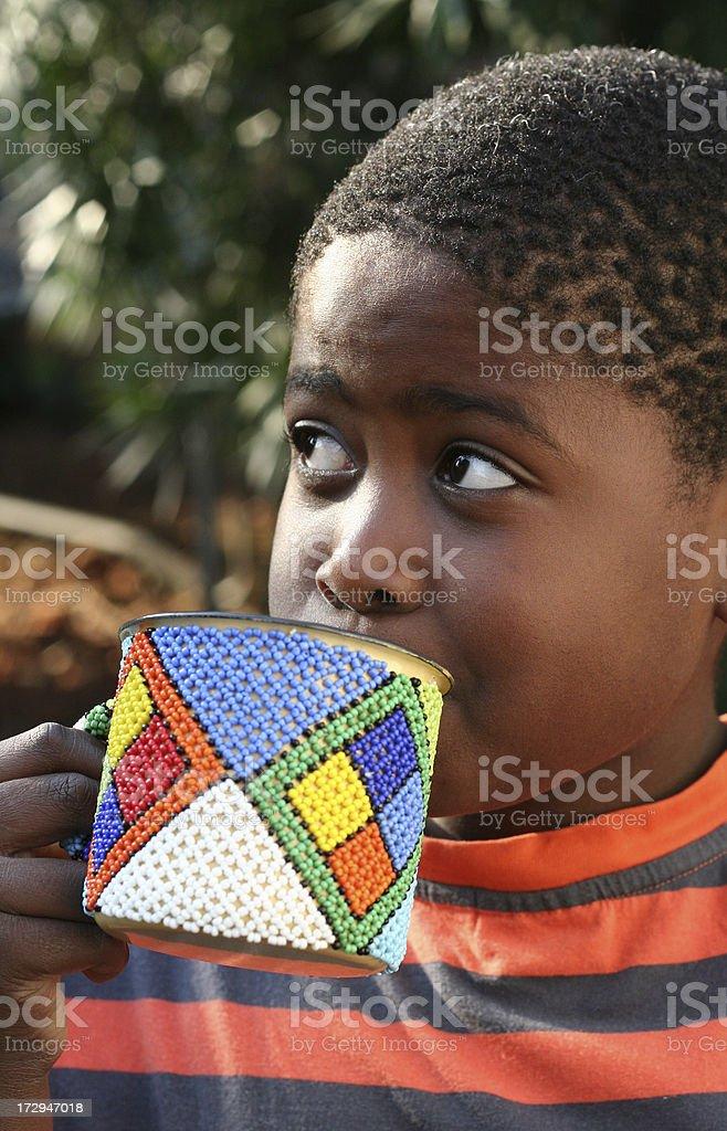 African boy drinking tea portrait royalty-free stock photo