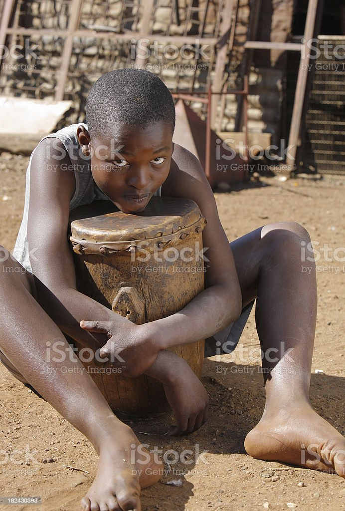 African boy with a drum South Africa stock photo