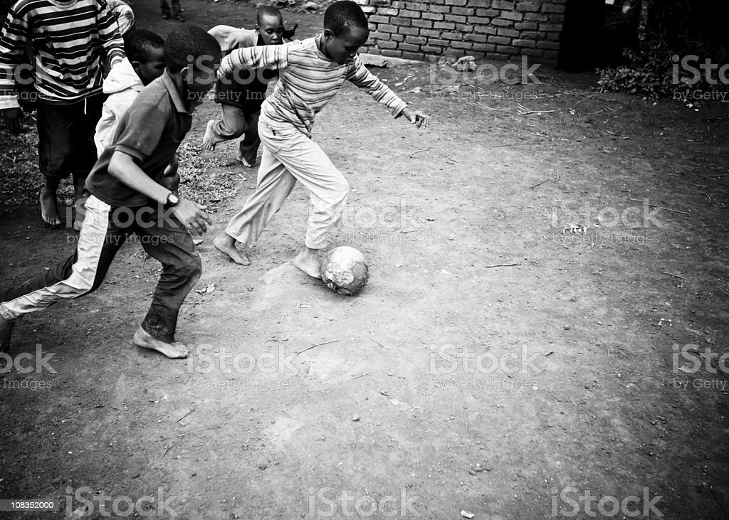 African Boys Playing Soccer royalty-free stock photo