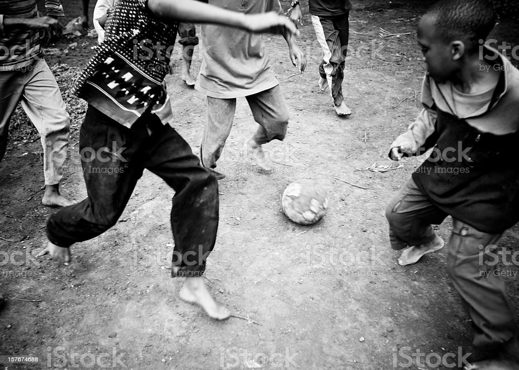 African Boys Playing Soccer stock photo