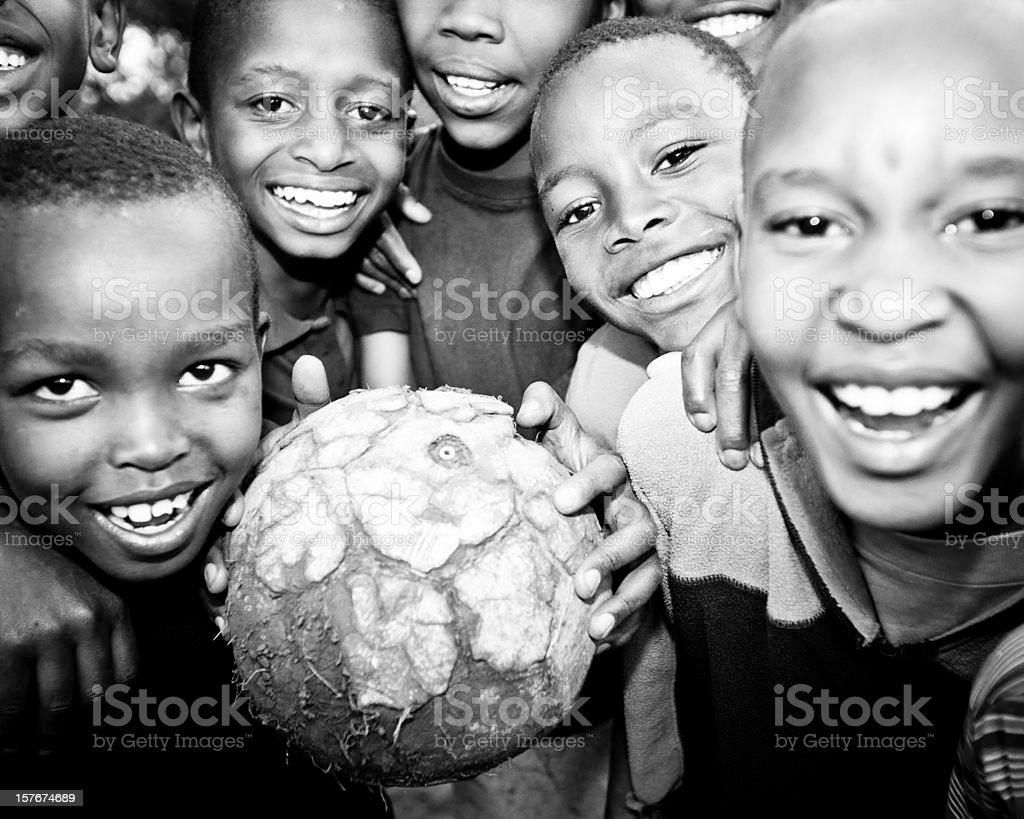 African boys smiling with a soccer ball royalty free stock photo