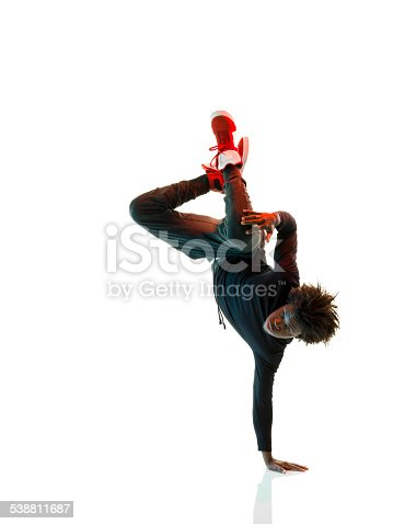 African breakdancer dancing on white background.