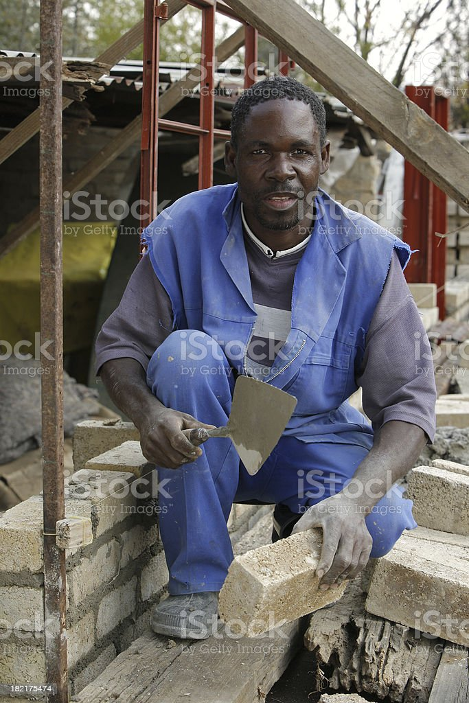 African building his own home stock photo