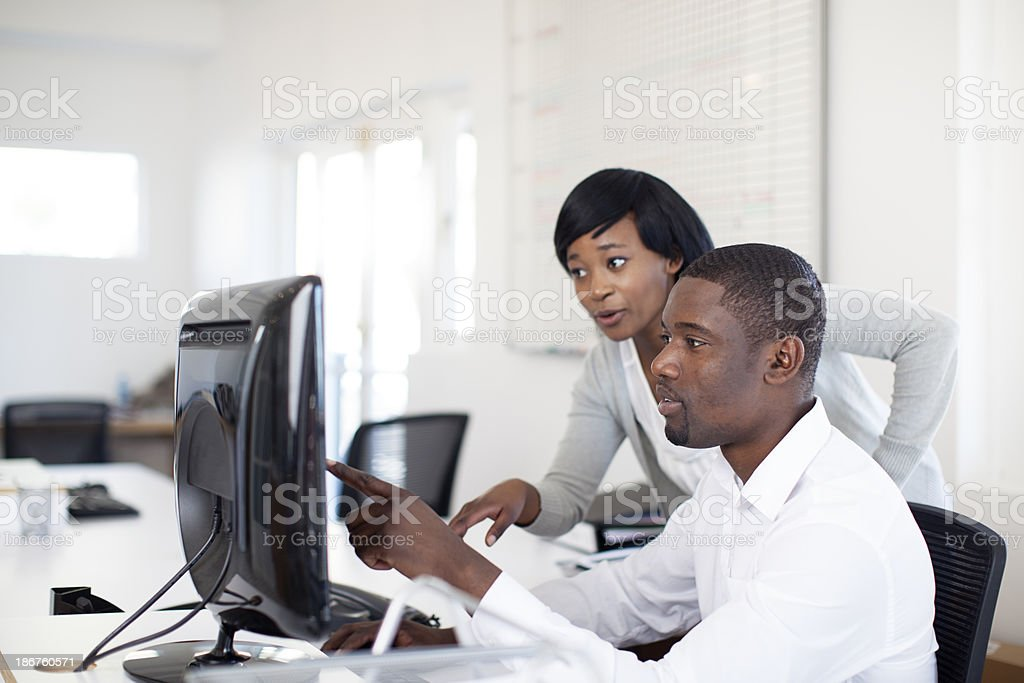 African Business Colleagues going through emails. royalty-free stock photo