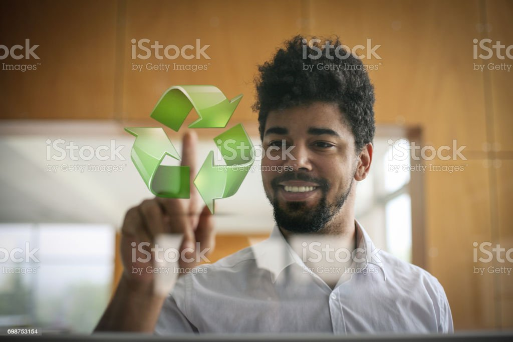African business man touching recycling symbol on virtual technology. Space for copy. stock photo
