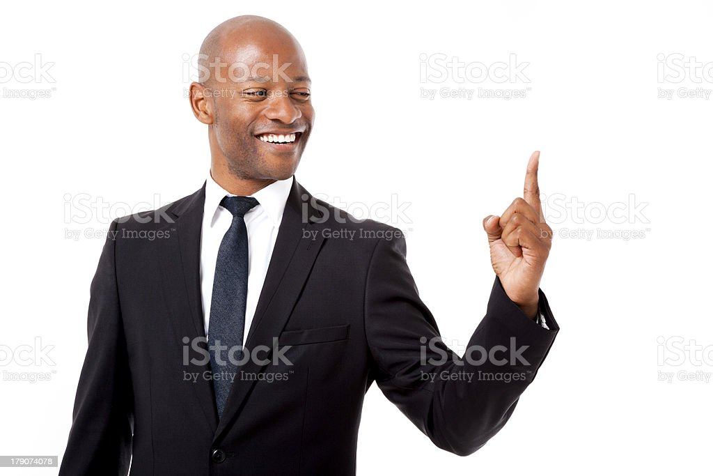 African business man with the world at his fingertips royalty-free stock photo