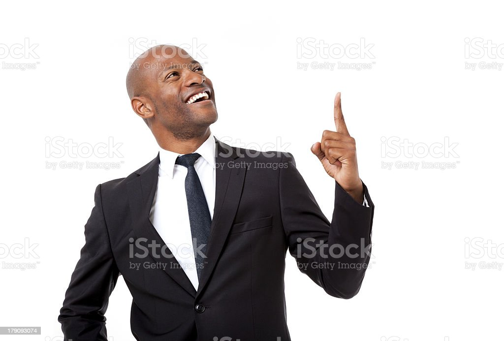 African business man with the world at his fingertips stock photo