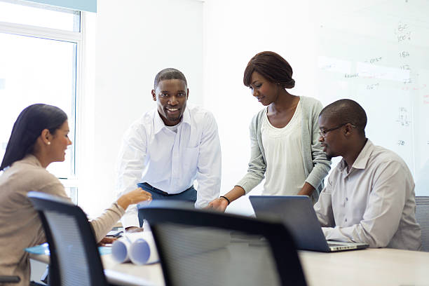 African business team discussing and planning together. stock photo