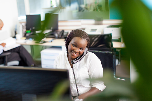 istock African business women smiling, having a telephone conversation 503677713