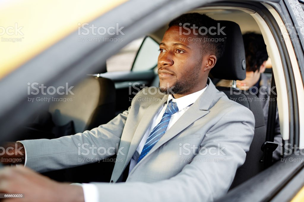 African Businessman Driving Car stock photo